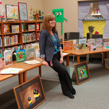 Author Denise Brennan-Nelson with her titles at Bennett Woods Elementary School