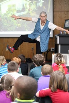 Visiting author entertaining students