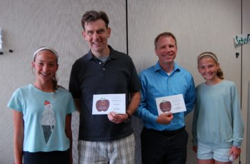 4 people standing: 2 students and two male teachers with their APPLE Awards: Chippewa Montessori program