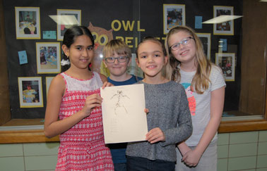 students show bones found in owl pellet