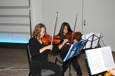 2 OHS strings students playing during the OEF Awards Banquet