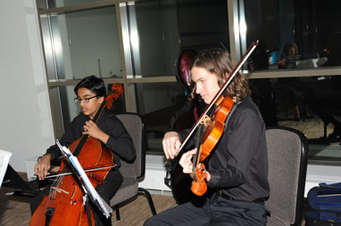 2 strings students playing during the OEF Awards Banquet