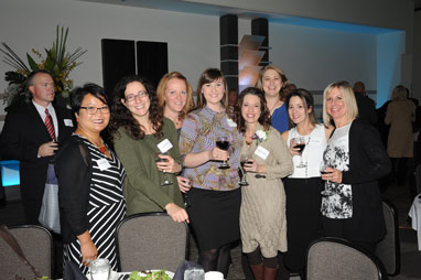 8 ladies, supporters of OEF Award recipient Nicole Langdon, at the banquet