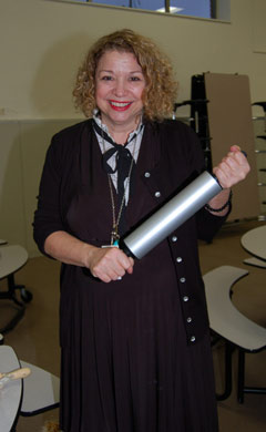 Teacher holding a rolling pin
