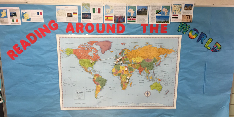 world map on bulletin board, blue background