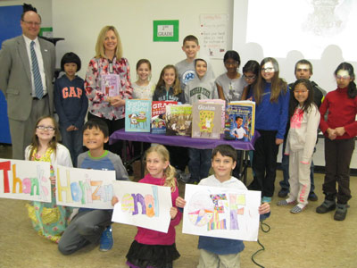 "Cornell elementary class with ""thank you"" sign"