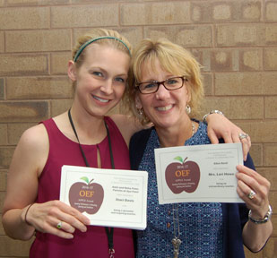 Mother and daughter, both with blond hair and both holding APPLE Awards